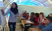 لاجئو كوباني ينشئون فصولا دراسية داخل الخيام