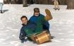 أرنولد شوارزينجر يتزلج على الجليد مع جورج بوش