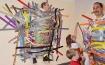 مدير مدرسة يسمح لطلابه بتعليقه على الحائط تنفيذا لوعده