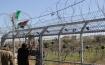 وضع العلم الفلسطيني على بوابة كرمي تسور