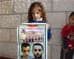 مستوطِنة تحاول اختطاف طفل الشهيد غسان أبو جمل
