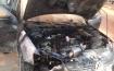 اشتعال النيران في سيارة قرب الدوار الاول بام الفحم على اثر التماس كهربائي