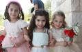 احد الشعانين في حرفيش: اغصان الزيتون والورود تزين شموع الأطفال