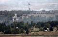 سوريا: عشرات القذائف على حي بدمشق واشتباكات في الجولان