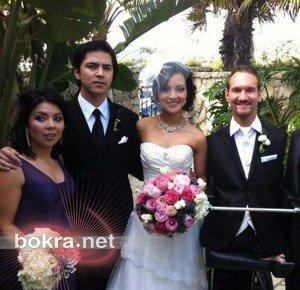 صور اشهر معاق مع زوجته